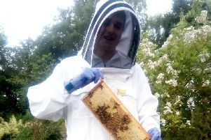 Martin Leahy, 15, started looking after bees when he was just nine-years-old when he started going along to his local club with mum Sarah, 52. Picture: SWNS