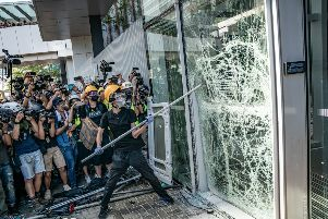 Protesters smash glass doors and windows of the Legislative Council Complex on July 1, 2019 in Hong Kong, China. (Photo by Anthony Kwan/Getty Images)