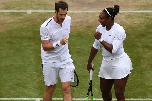Andy Murray celebrates with Serena Williams. Picture: AFP/Getty Images