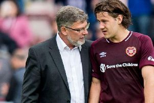 Craig Levein (left) with Peter Haring, who is still struggling with injuries. The Hearts boss has accepted partial responsibility for the Austrian's woes