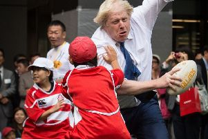 Johnson barged into Toki Sekiguchi, 10, while playing rugby in Tokyo in 2015. Toki said he felt 'a little bit of pain but it's OK' (Picture: Stefan Rousseau/PA)