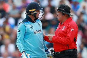 Umpire Marais Erasmus has to step in as Jason Roy protests after being given out caught behind. Picture: David Rogers/Getty