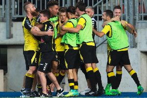 Progres Niederkorn's players celebrate after scoring against Rangers in 2017.