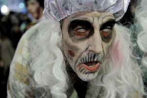 Parades in Sitges are a bit different to many in Scotland, as this man, dressed as a member of the living dead takes part in a Zombie Walk, demonstrates (Picture: Josep Lago/AFP/Getty Images)