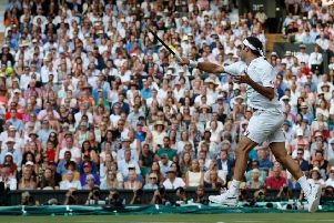 Roger Federer fires another booming forehand back at Rafael Nadal on Centre Court