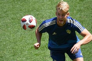 Filip Helander gets stuck in during a Sweden training sessions. The defender has ten international caps