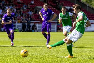 Scott Allan, now in his third spell with Hibs, slots home his penalty to put the vistors ahead just before half-time. Picture: SNS