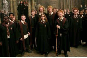 DEVON MURRAY as Seamus Finnegan, MATTHEW LEWIS as Neville Longbottom, OLIVER PHELPS as George Weasley, EMMA WATSON as Hermione Granger, JAMES PHELPS as Fred Weasley, RUPERT GRINT as Ron Weasley and CHRIS RANKIN as Percy Weasley in a scene from Harry Potter and the Prisoner of Azkaban.