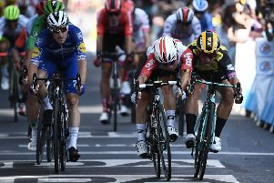 Caleb Ewan, centre, beats Dylan Groenewegen, right, and Elia Viviani, left, to the line in Toulouse. Picture: Anne-Christine Poujoulat/AFP/Getty