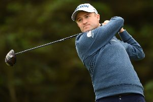 Russell Knox tees off on the fifth hole during the first round of the Open Championships at Royal Portrush. Picture: AFP/Getty
