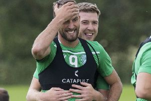 Christian Doidge, left, and Josh Vela get friendly during a Hibs training session. Picture: Paul Devlin/SNS