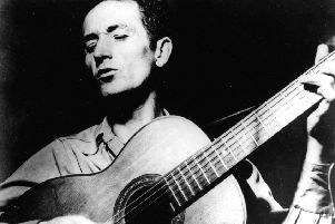 Woody Guthrie sang about the racism of the current US President's father Fred (Picture: AP)