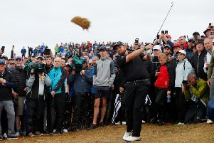 Shane Lowry takes a huge divot as he plays a shot on the 17th. Picture: Kevin C. Cox/Getty