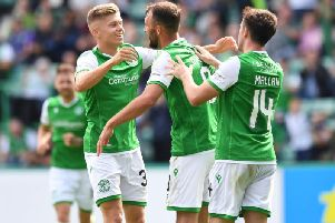 Christian Doidge, centre, celebrates after scoring his first goal for Hibs.