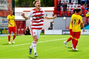 Ross Cunningham celebrates after scoring to make it 2-1 to Accies.