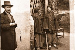 John Thomson standing next to two Manchu soldiers in Xiamen, on the southern 'frontier of the Qing empire. Pictures: The Wellcome Library