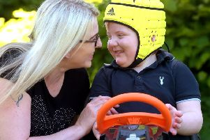 Karen Gray with Murray who is now able to play and attend school. Photograph: Lisa Ferguson