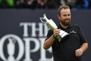 Shane Lowry celebrates winning the 148th Open at Royal Portrush