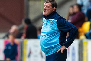 St Johnstone boss Tommy Wright cuts a dejected figure on the touchline as Ross County take the three points at McDiarmid Park