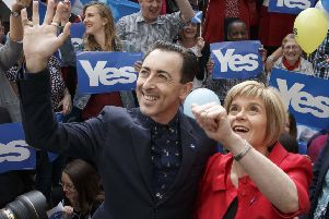 Alan Cumming and Nicola Sturgeon at a flash mob meeting in Glasgow in September 2014 (Picture: Robert Perry)