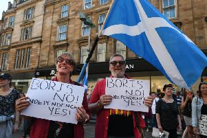 Pro-independence supporters stages an 'anti-Boris' rally in Glasgow yesterday