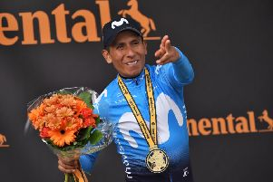 Colombia's Nairo Quintana celebrates on the podium in Valloire. Picture: Marco Bertorello / AFP/Getty