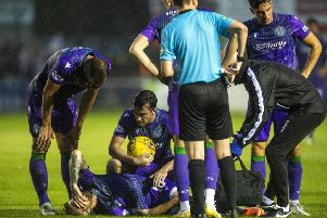 Hibs players console Martin Boyle after the winger went down injured late on against Elgin. Picture: Craig Foy/SNS
