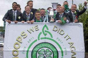 The triumphant Celtic players enjoy an open-top bus ride around Glasgow following their victory in last season's Betfred Cup final. Picture: SNS.
