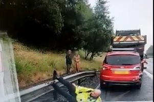 The officer ends up flat on his back after taking a tumble.