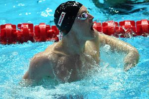 Duncan Scott lets out a roar of triumph after anchoring the Great Britain team to victory in the 4x400m medley at the World Championships in Gwangju. Picture: AFP/Getty.