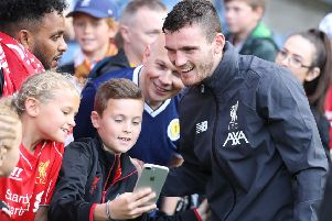 Andy Robertson poses for a selfie with fans at Murrayfield. Picture: Getty.