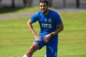 Kilmarnock's Gary Dicker limbers up for the start of the new Premiership season. Picture: Ross MacDonald