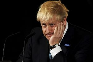 Opponents of Prime Minister Boris Johnson accused him 'breaking the economy'.  (Picture: Rui Vieira/AP)