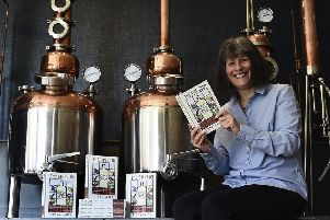 Fiona Laing with her book The Gin Clan. Picture: Lisa Ferguson