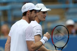 Andy Murray (left) and Jamie squeezed past Mahut and Roger-Vasselin