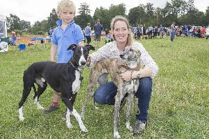Edwina Stacy-Marks had the Champion Lurcher of the show, Jay on the left, pictured with his mum Teal and Edwina's son Rowan.