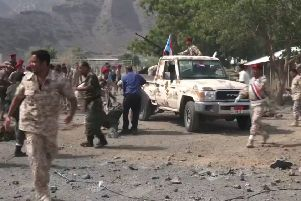 Dozens of Yemeni police, including a senior commander, were killed or wounded in the attack, according to a security source. The missile attack, which came as a suicide bomber killed at last three police in the Sheikh Othman area of the southern port city, was claimed by Huthi rebels who control the capital Sanaa. (Photo by Nabil HASAN / AFP)NABIL HASAN/AFP/Getty Images