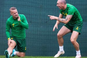 Scott Brown jokes with Leigh Griffiths during training