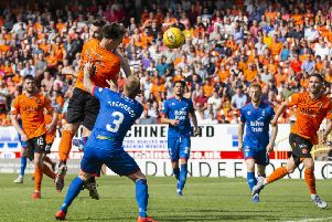 Dundee United new boy Lawrence Shankland bullets his third header in to make it 3-1. Photograph: Bruce White/SNS Group