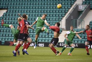 Ryan Porteous heads in the opener for Hibs U21 against Elgin. Picture: Andrew O'Brien