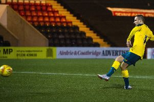 Liam Burt slots home the winning penalty for Celtic. Picture: SNS