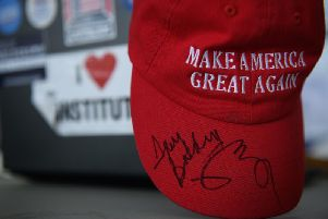 Some people bought a 'Make America Great Again' cap thinking it would be a political curiosity of Donald Trump's failed election bid. But then he won. (Picture: Getty)