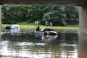 Firefighters help motorists stuck in the floodwater. Pic: Donald Stirling.