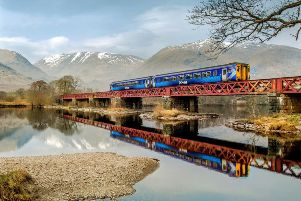 Scotrail 156 super sprinter crosses the head of Loch Awe on the Glasgow-Oban line,near Dalmally