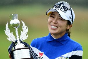 Korea's Mi Jung Hur shows her delight after picking up a new ASI Ladies Scottish Open trophy. Picture: Getty.