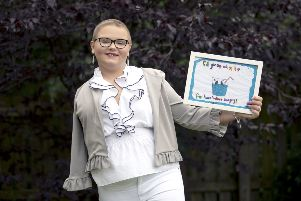 Skye Duncan, 14, from Gartloch, Glasgow, with a poster she designed using her left hand, which won a hospital art competition, shortly after her right arm was amputated following her battle with Osteosarcoma an aggressive form of bone cancer. Picture: Jane Barlow/PA Wire