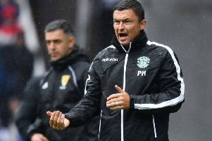 The rain clouds gathered over Hibs manager Paul Heckingbottom in Sunday's heavy defeat by Rangers. Picture: SNS.
