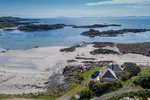 The cottage sits right next to the beach.
