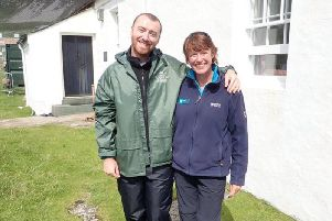 Singer Sam Smith with NTS ranger Sue Loughran on St Kilda yesterday. PIC: Contributed.