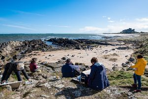 Sketching on the beach in front of Bamburgh Castle. Picture: Julie Gregory